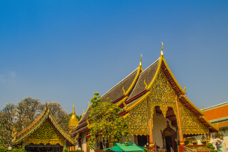 Beautiful golden buddhist church in Lanna-style ordination hall enshrines at Wat Chiang Man or Wat Chiang Mun, the oldest temple in Chiang Mai, Thailand, built in 1296 by King Mengrai in Lanna-style.