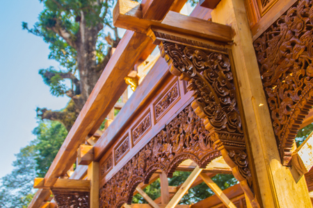 Traditional Thai style wooden carving pattern on the corridor at the luxury building construction site.