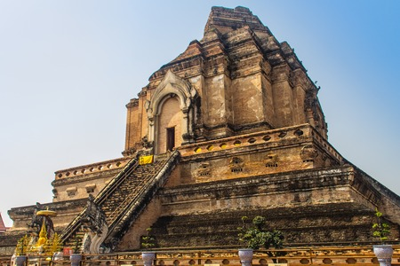 Old massive ruins pagoda of Wat Chedi Luang (temple of the big royal stupa), located in Chiang Mai, Thailand. Wat Chedi Luang was built in 1383 and the structure collapsed after an earthquake in 1545.