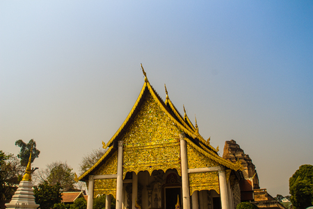 Lannas style golden patterned background on the Buddhist church gable end. Thai golden pattern background crafted on the gable in the Buddhist temple with Lanna style at Wat Chedi Luang, Chiang Mai. Stock fotó
