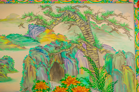 Green dwarf pine tree on the cliff painting in the public Chinese temple. Green Pine Tree Wall Drawing Seamless Pattern Editorial