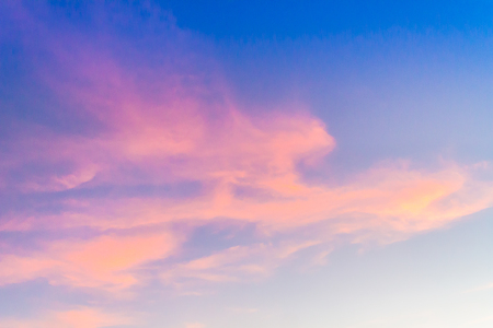 Dramatic red cloud against blue sky in the evening before sunset and sunrise.