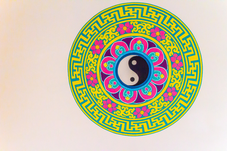 Golden symbol of Yin - Yang on the ceiling of Chinese temple. Yin and Yang is that all things exist as inseparable and contradictory opposites, for example, female-male, dark-light and old-young.