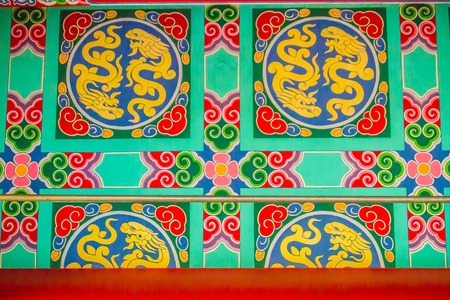 Colorful architecture and art of wall painting with red dragon pattern in the public Chinese temple. Tradition red Chinese dragon painting on Chinese temple wall Editorial
