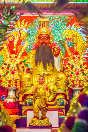Beautiful golden Guan Yu statue in the public Chinese temple. Guan Yu is the god warrior in the Three Kingdoms period. Editorial