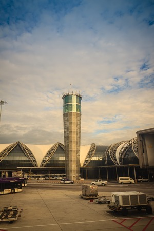 Bangkok, Thailand - August 9, 2017: Airplane control tower and the terminal building with blue sky background at Suvarnabhumi International Airport, Thailand. Editorial