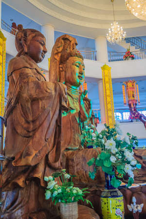 Beautiful wood statue of Guan Yin at Huay Pla Kang Temple, Chiang Rai, Thailand. Guan Yin is a female Bodhisattva in Thai Buddhism, which means someone that reached enlightenment. Editorial