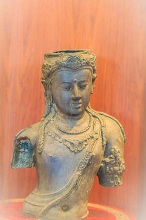 Old bronze statue of Avalokiteshvara, or The Lord Who Looks Down. Avalokiteshvara is a bodhisattva in the Buddhist belief system. Lord of the Dharma who looks upon all beings with infinite compassion
