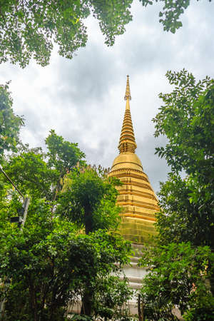 Beautiful golden pagoda at Wat Phra Kaew, one of the oldest and most revered Buddhist temples in Chiang Rai, Thailand.