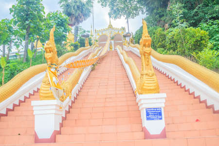 Beautiful nagas staircase upward to the temple at Wat Phra That Chom Sak, thai public Buddhist temple. Located in Mueang, Chiang Rai Province, Built during the Yonok Chai Buri Si Chiang Saen period.