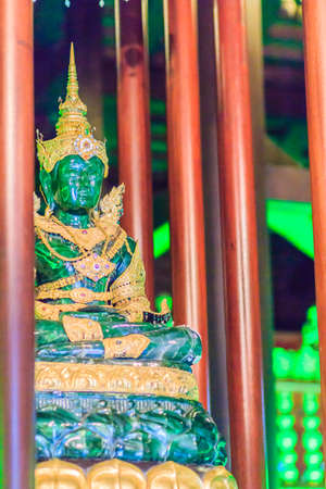 Beautiful jade Buddha image at Wat Phra Kaew, Chiang Rai, Thailand. Wat Phra Kaew is the original home of the translucent green Buddha which graces the Emerald Buddha Temple in Bangkok's Grand Palace Stock Photo