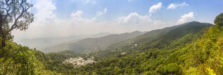 Panorama view of Doi Pui Hmong ethnic hill-tribe village, aerial view green forest on the mountain background. Doi Pui Hmong tribal village is located on Doi Suthep-Pui national park, Chiang Mai. Archivio Fotografico