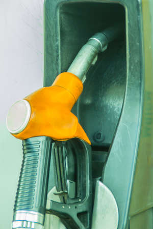 Yellow fuel oil dispenser at petrol filling station. Fuel dispensing pump at a gas station. Archivio Fotografico