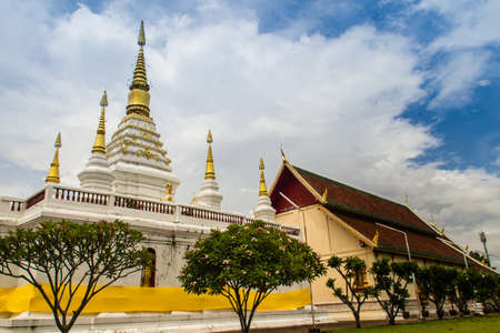 Beautiful landscape and white gold pagoda of Wat Jed Yod, Chiang Rai, Thailand. Wat Chet Yot is a temple that has been renovated from the remains of an ancient temple.
