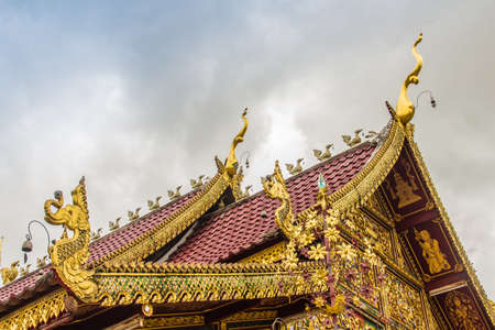 Beautiful art, religious places and religious objects in Myanmar mixed with Lanna style at Wat Ming Muang Buddhist temple, Chiang Rai, Thailand. Mixed Lanna and Burmese arts. Archivio Fotografico