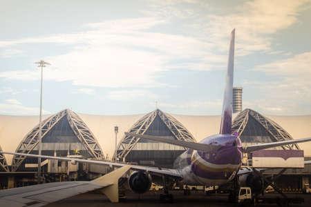 Bangkok, Thailand - June 13, 2017: Terminal building with the airplanes at Suvarnabhumi international airport, Bangkok, Thailand. Editoriali