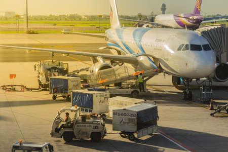 Bangkok, Thailand - June 13, 2017: Airplane staffs of Bangkok Airways (a regional airline based in Bangkok) is uploading baggage before taking off at Suvarnabhumi Airport. Editoriali