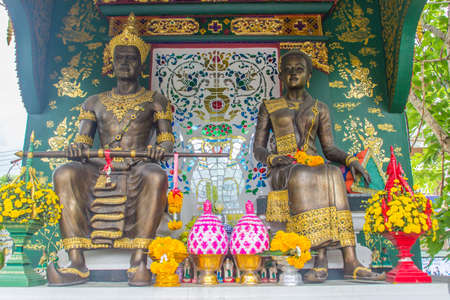 King Mangrai and his queen statues at Wat Ming Muang Buddhist temple, Chiang Rai, Thailand. King Mangrai, also known as Mengrai. He founded the city of Chiang Rai as his new capital of Lanna in 1262. Editoriali