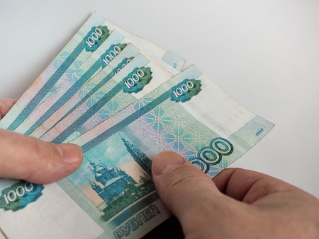 Russian rubles in the hands of men