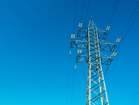 High voltage power line on blue sky background in Sunny day Stock Photo