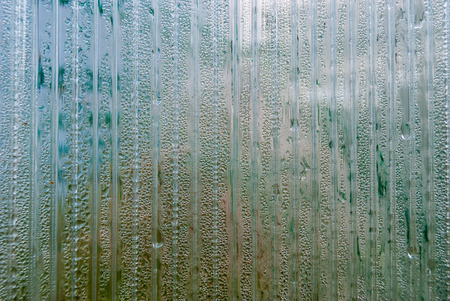 The texture of polycarbonate, divided into sections and water drop Stock Photo