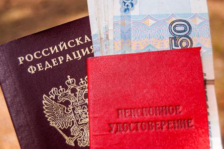 Russian passport, pension certificate and money-Russian translation: pension certificate. Banco de Imagens