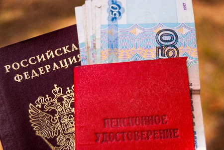 Russian passport, pension certificate and money-Russian translation: pension certificate. Banco de Imagens