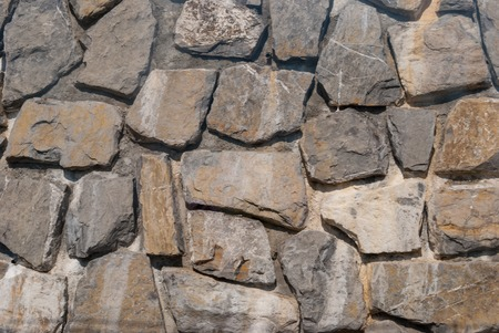 A fragment of stonework from the large natural stone. Stock Photo