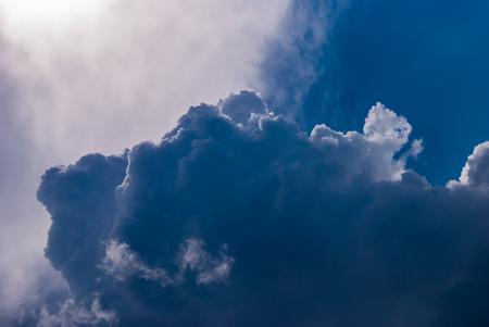 White cumulonimbus clouds on blue sky background.