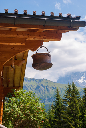 Traditional old pot hanging from the roof in the mountain of Switzerland.