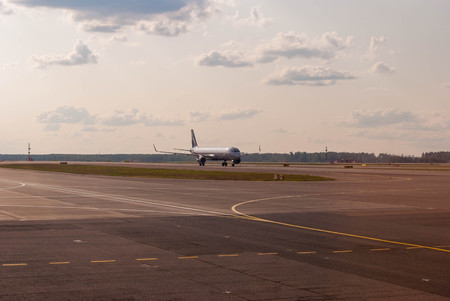 Front view of a passenger plane on the airport runway Фото со стока