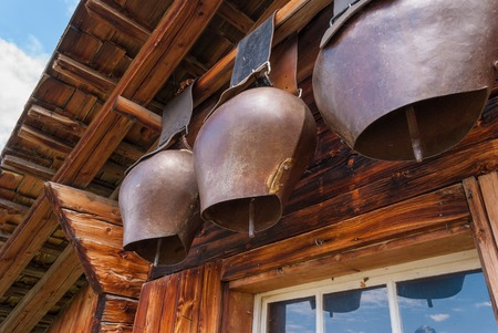 old cow bells under the roof of an Alpine mountain hut. Switzerland