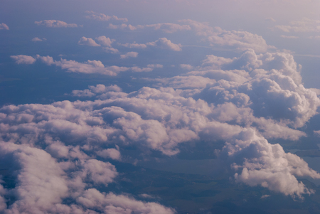 top view of the clouds and the blue sky from the plane window, the background of nature. Reklamní fotografie