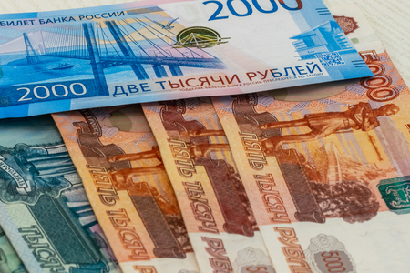 various old and new Russian banknotes close up as background.