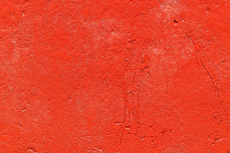 Old plastered wall painted with fresh red paint. Abstract background of red walls, close up Banco de Imagens - 124699111