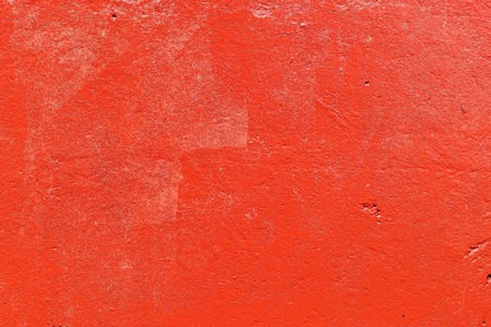 Old plastered wall painted with fresh red paint. Abstract background of red walls, close up Banco de Imagens - 124686730