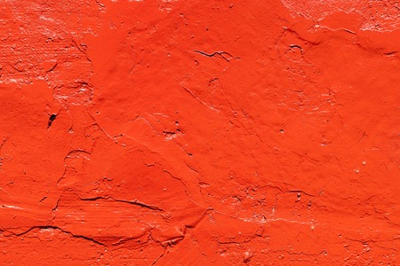 Old plastered wall painted with fresh red paint. Abstract background of red walls, close up Banco de Imagens - 124686725