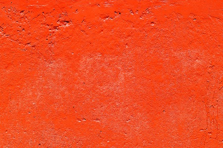 Old plastered wall painted with fresh red paint. Abstract background of red walls, close up Banco de Imagens - 124686734