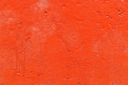Old plastered wall painted with fresh red paint. Abstract background of red walls, close up Banco de Imagens - 124699234