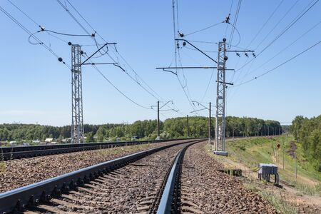 contact wires and broad gauge rails in the perspective of the spring day. industry railway transportation, logistics. Moscow region Russia