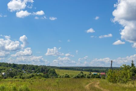 Bright summer landscape with blue sky. Green fields in the countryside. Moscow region Russia