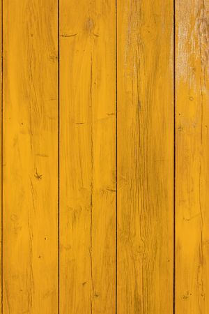 Yellow painted wood texture, Wooden fence in the background