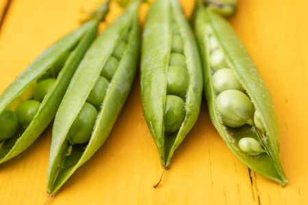 Beautiful close-up of green fresh peas and pea pods. Healthy food, vitamins Banco de Imagens