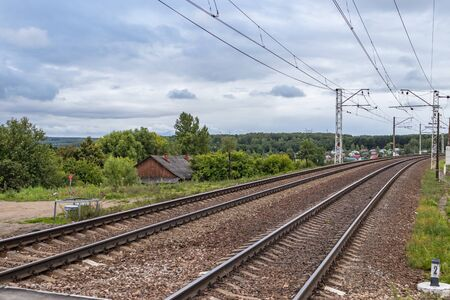 Railway in Tula region, Russia. landscape with railway track, sky with clouds, trees and grass, railway junction. travel. nobody. transportation