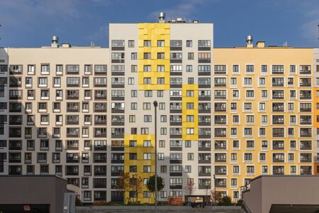 Modern apartment building with colorful facades on the outskirts of the city. Residential Complex 'In the forest', Moscow Russia