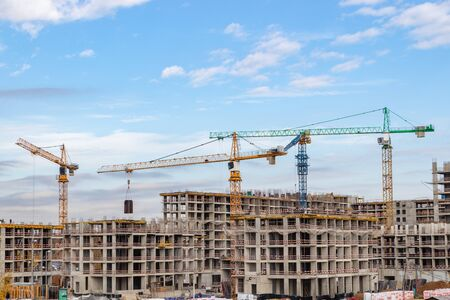 Construction of the third stage of a new residential complex in the forest. Work construction cranes, is the construction of walls of buildings. Moscow Russia