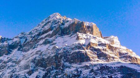 Mountain landscape of Mettenburg peak in winter, Grindelwald, Canton of Bern, Switzerland Banco de Imagens