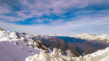 Winter mountain landscape with a view of the Caucasus range covered with snow on a Sunny day. Krasnaya Polyana, Sochi, Russia