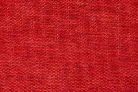 covering fabric with a natural texture. dark red background made of soft textile material, the fabric background.