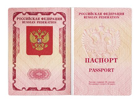 Open foreign passport of a citizen of the Russian Federation isolated on a white background. close- up